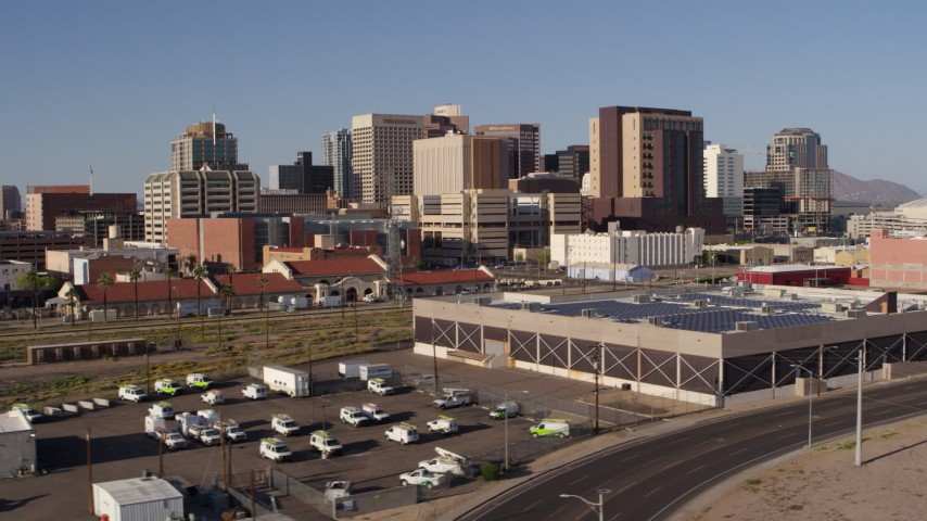 5.7K stock footage aerial video fly past train station and government building with view of skyline in Downtown Phoenix, Arizona Aerial Stock Footage | DX0002_142_024