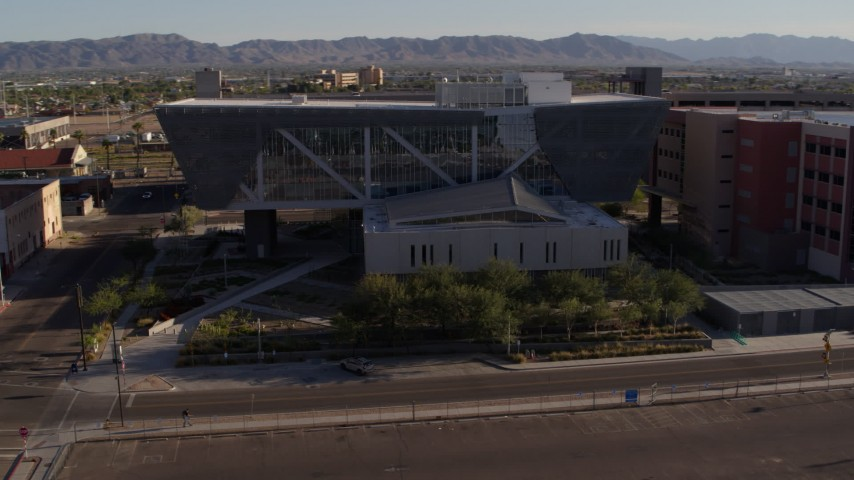 5.7K stock footage aerial video of an orbit of the Maricopa County Sheriff's Office at sunset in Downtown Phoenix, Arizona Aerial Stock Footage | DX0002_142_027
