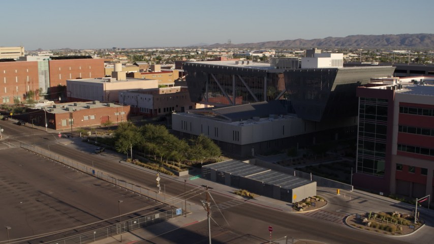 5.7K stock footage aerial video a slow orbit of the Maricopa County Sheriff's Office at sunset in Downtown Phoenix, Arizona Aerial Stock Footage | DX0002_142_033