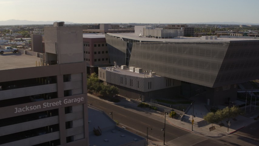 5.7K stock footage aerial video fly away from the Maricopa County Sheriff's Office and parking garage at sunset in Downtown Phoenix, Arizona Aerial Stock Footage | DX0002_142_035