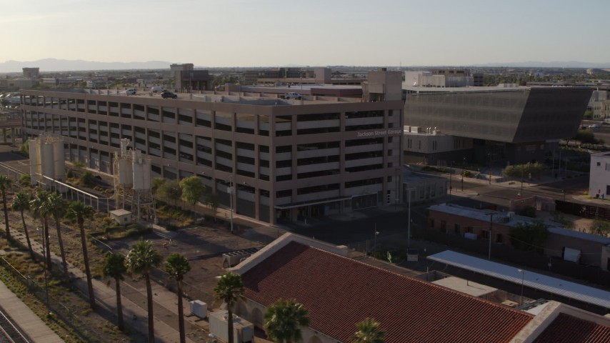 5.7K stock footage aerial video fly away from and orbit parking garage by the sheriff's office at sunset in Downtown Phoenix, Arizona Aerial Stock Footage | DX0002_142_036