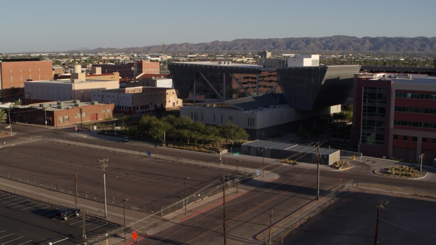 5.7K stock footage aerial video of the Maricopa County Sheriff's Office at sunset in Downtown Phoenix, Arizona Aerial Stock Footage | DX0002_142_038