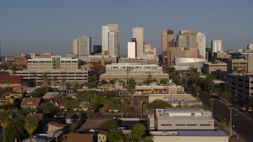 5.7K stock footage aerial video approach high-rise office buildings of the city's skyline at sunset in Downtown Phoenix, Arizona Aerial Stock Footage | DX0002_143_001