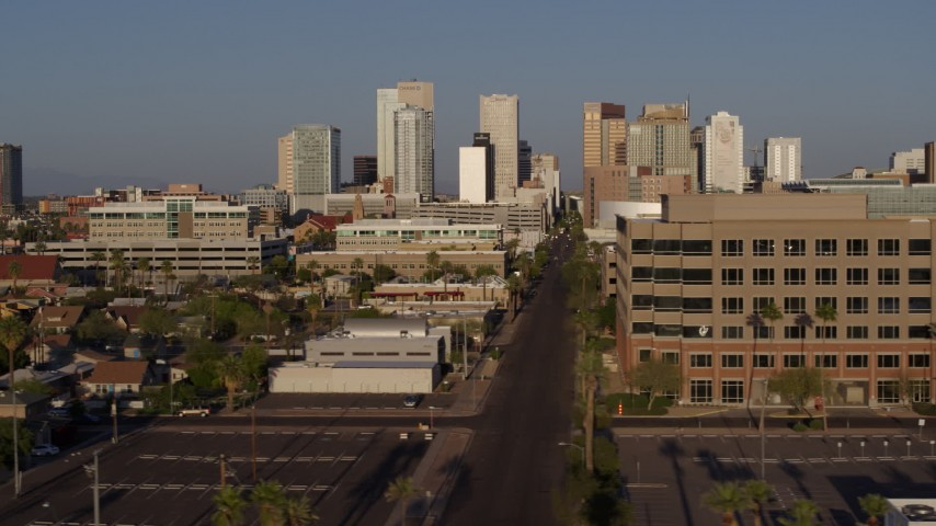 5.7K stock footage aerial video flyby state offices and Adams Street for view of city's skyline at sunset in Downtown Phoenix, Arizona Aerial Stock Footage | DX0002_143_011