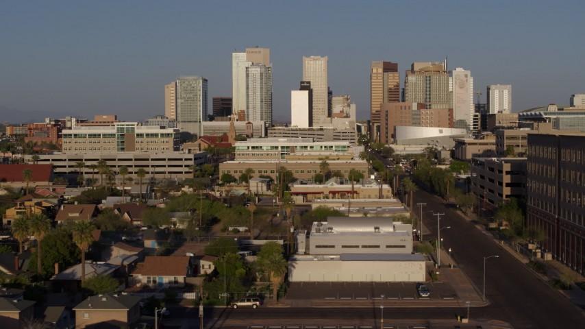 5.7K stock footage aerial video follow Adams Street toward city's skyline at sunset in Downtown Phoenix, Arizona Aerial Stock Footage | DX0002_143_012
