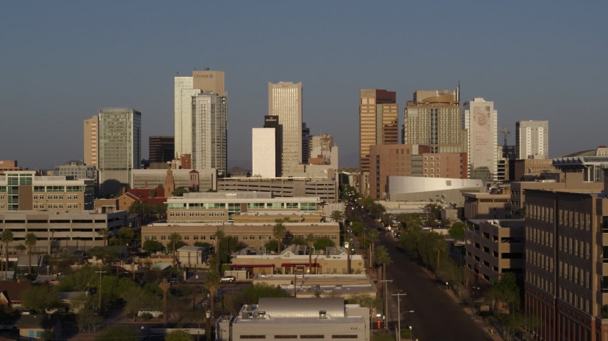 5.7K stock footage aerial video of Adams Street leading to the city's towering skyline at sunset, Downtown Phoenix, Arizona Aerial Stock Footage | DX0002_143_019