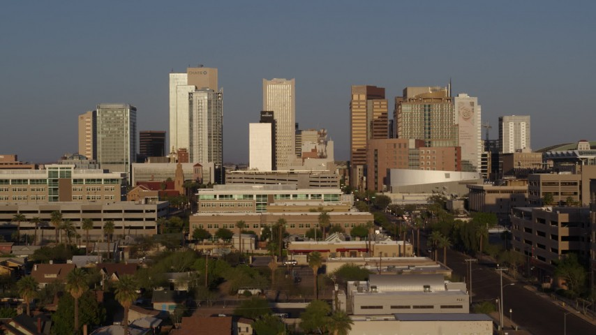 5.7K stock footage aerial video slow approach to city's skyline at sunset near Adams Street, Downtown Phoenix, Arizona Aerial Stock Footage | DX0002_143_020