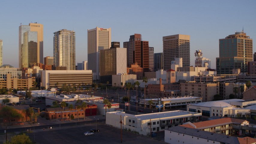 5.7K stock footage aerial video of flying toward the city's skyline at sunset, Downtown Phoenix, Arizona Aerial Stock Footage | DX0002_143_032