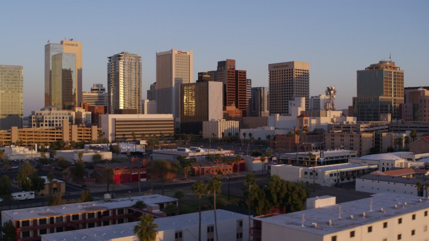 5.7K stock footage aerial video of a reverse view of the city's skyline at sunset, Downtown Phoenix, Arizona Aerial Stock Footage | DX0002_143_034