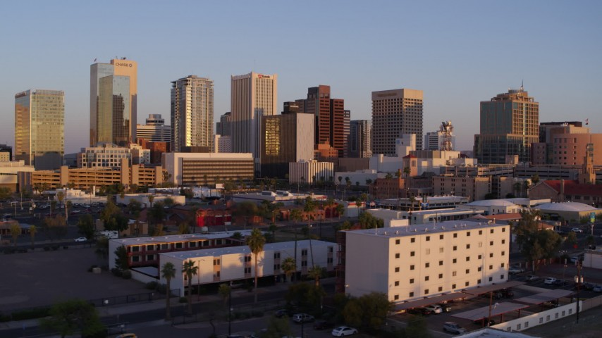 5.7K stock footage aerial video of passing the city's skyline at sunset, Downtown Phoenix, Arizona Aerial Stock Footage | DX0002_143_036