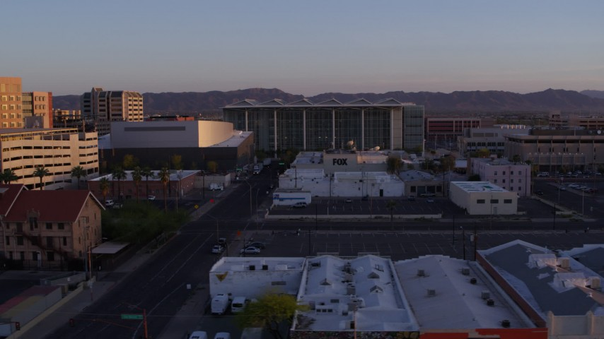 5.7K stock footage aerial video of flying past a performing arts theater, courthouse and TV station at sunset, Downtown Phoenix, Arizona Aerial Stock Footage | DX0002_143_037
