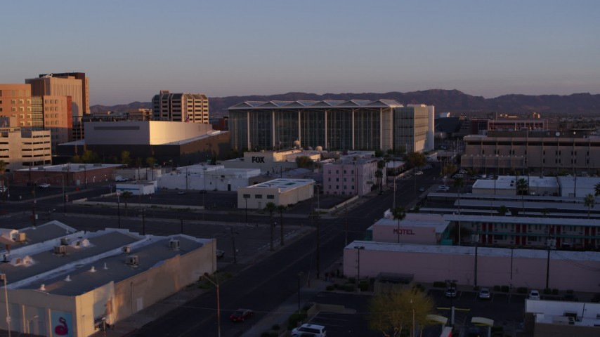 5.7K stock footage aerial video of a view of a performing arts theater, courthouse and TV station at sunset, Downtown Phoenix, Arizona Aerial Stock Footage   DX0002_143_039