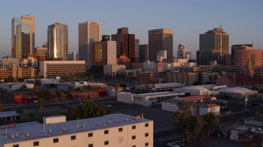 5.7K stock footage aerial video of tall office towers in the city's skyline at sunset, Downtown Phoenix, Arizona Aerial Stock Footage | DX0002_143_041