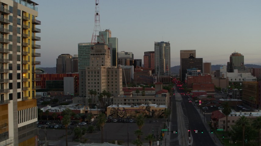 5.7K stock footage aerial video of Westward Ho building and tall office towers at sunset, Downtown Phoenix, Arizona Aerial Stock Footage | DX0002_143_046