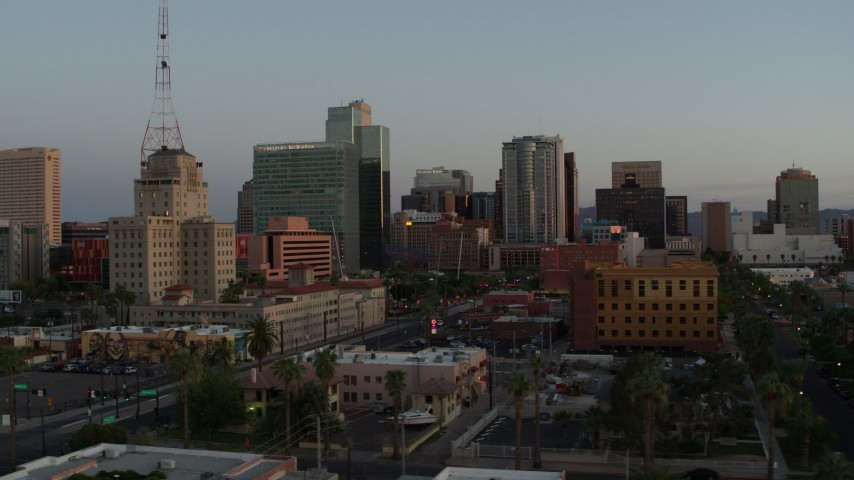 5.7K stock footage aerial video of a view of the Westward Ho building and tall office towers at sunset, Downtown Phoenix, Arizona Aerial Stock Footage | DX0002_143_047