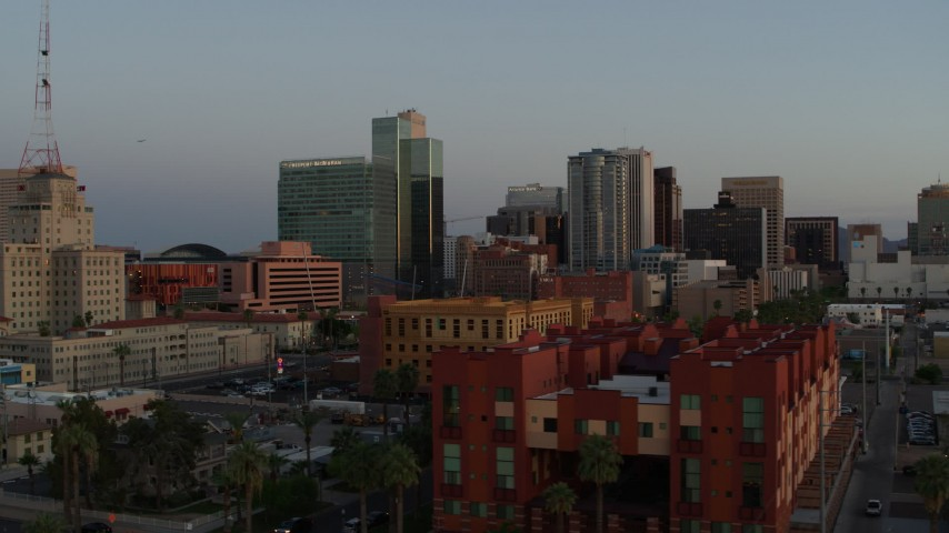 5.7K stock footage aerial video of towering office buildings seen from 2nd Avenue at sunset, Downtown Phoenix, Arizona Aerial Stock Footage   DX0002_143_048