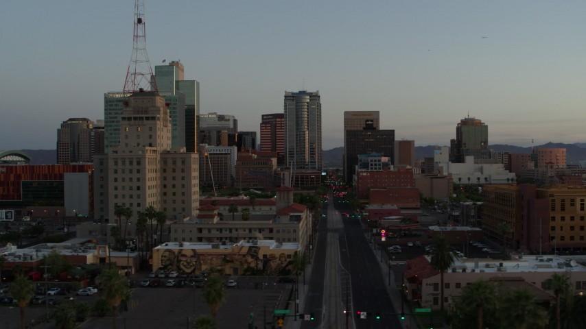 5.7K stock footage aerial video of passing towering office buildings seen from 1st Avenue at sunset, Downtown Phoenix, Arizona Aerial Stock Footage DX0002_143_050