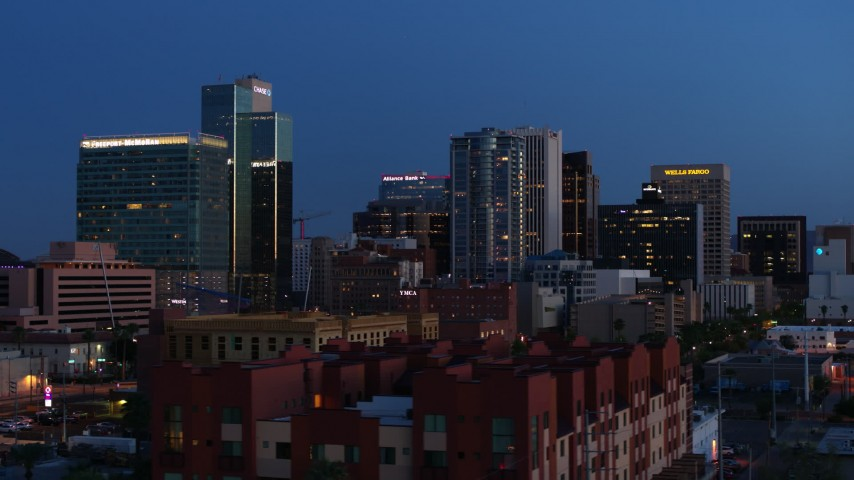 5.7K stock footage aerial video of towering office buildings, seen from 1st and 2nd Avenue at twilight, Downtown Phoenix, Arizona Aerial Stock Footage | DX0002_143_058
