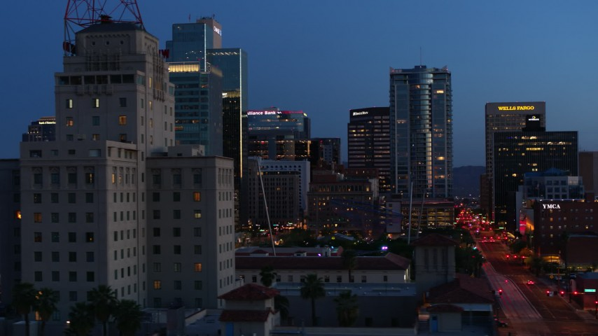 5.7K stock footage aerial video flyby tall office buildings, and reveal Westward Ho building at twilight, Downtown Phoenix, Arizona Aerial Stock Footage | DX0002_143_059