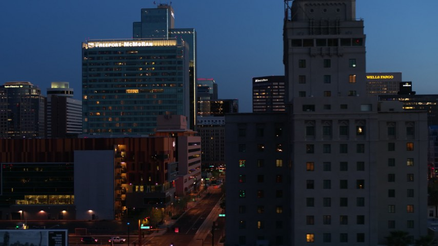 5.7K stock footage aerial video passing high-rise office buildings, and reveal Westward Ho building at twilight, Downtown Phoenix, Arizona Aerial Stock Footage | DX0002_143_060