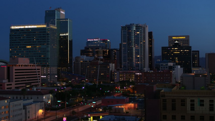 5.7K stock footage aerial video approach and flyby high-rise office buildings at twilight, Downtown Phoenix, Arizona Aerial Stock Footage   DX0002_143_061
