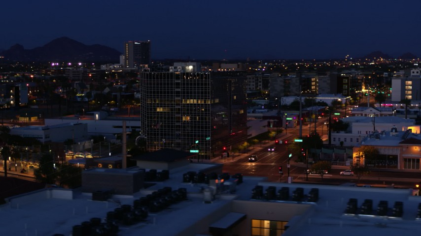 5.7K stock footage aerial video of circling a glass office building at twilight, Downtown Phoenix, Arizona Aerial Stock Footage | DX0002_143_066