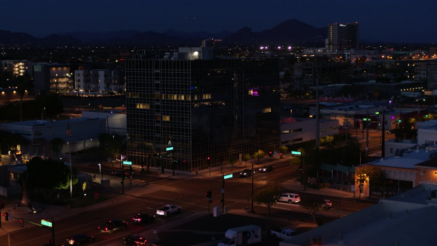 5.7K stock footage aerial video orbit and approach glass office building at twilight, Downtown Phoenix, Arizona Aerial Stock Footage | DX0002_143_067