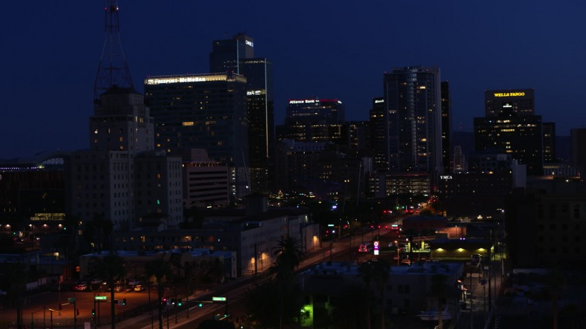 5.7K stock footage aerial video flyby Westward Ho building to approach high-rise office buildings at twilight, Downtown Phoenix, Arizona Aerial Stock Footage | DX0002_143_068