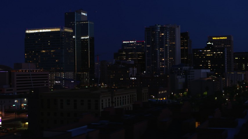 5.7K stock footage aerial video slowly flying by high-rise office buildings at twilight, Downtown Phoenix, Arizona Aerial Stock Footage | DX0002_143_070