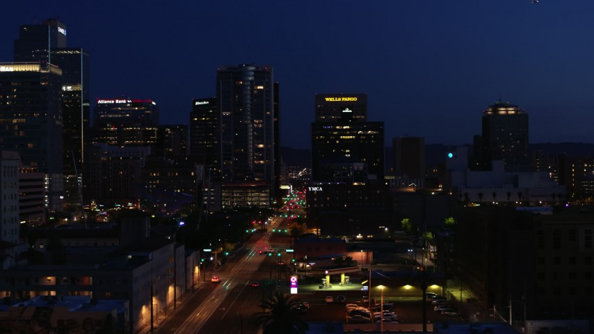 5.7K stock footage aerial video flyby building to reveal 1st Avenue and high-rise office towers at twilight, Downtown Phoenix, Arizona Aerial Stock Footage | DX0002_143_073