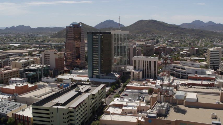 5.7K stock footage aerial video of ascending past office high-rises, with Sentinel Peak in the distance, Downtown Tucson, Arizona Aerial Stock Footage | DX0002_144_002