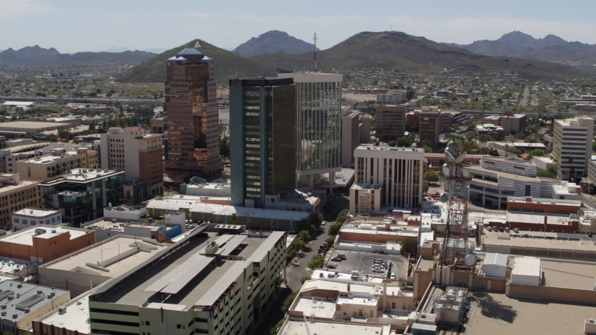5.7K stock footage aerial video of orbiting high-rise office buildings, view of Sentinel Peak, Downtown Tucson, Arizona Aerial Stock Footage | DX0002_144_003