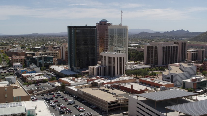 5.7K stock footage aerial video of a wide orbit around three tall office high-rises in Downtown Tucson, Arizona Aerial Stock Footage | DX0002_144_008