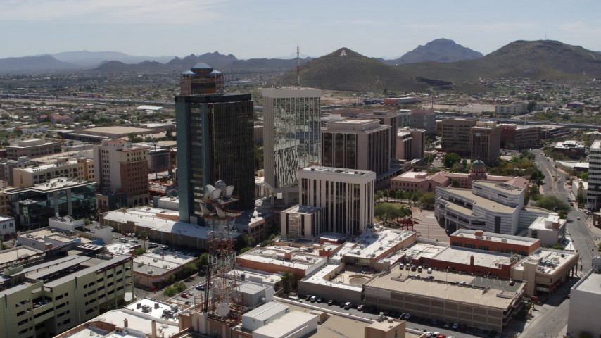 5.7K stock footage aerial video of orbiting three downtown office high-rises with Sentinel Peak in the distance, Downtown Tucson, Arizona Aerial Stock Footage | DX0002_144_010