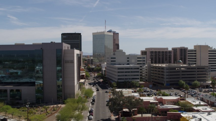 5.7K stock footage aerial video fly past courthouse, ascend and orbit tall high-rise office buildings, Downtown Tucson, Arizona Aerial Stock Footage | DX0002_144_012
