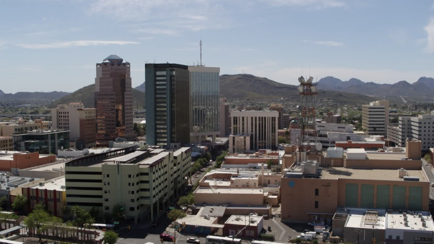 5.7K stock footage aerial video descend and orbit high-rise office buildings in Downtown Tucson, Arizona Aerial Stock Footage DX0002_144_014 | Axiom Images