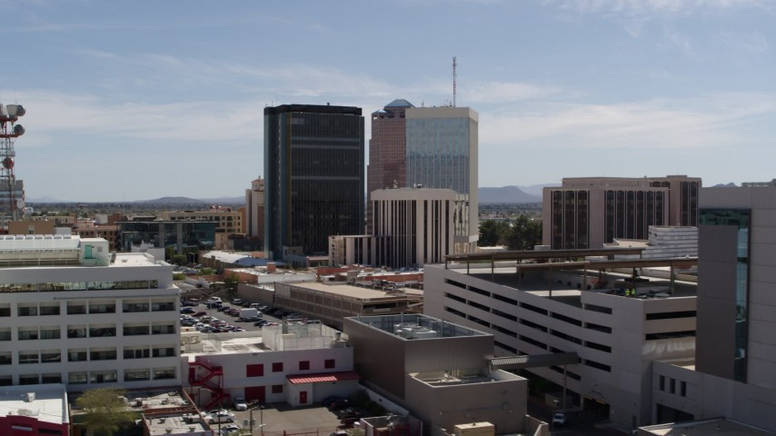 5.7K stock footage aerial video of orbiting rooftops while focused on office high-rises, Downtown Tucson, Arizona Aerial Stock Footage | DX0002_144_015