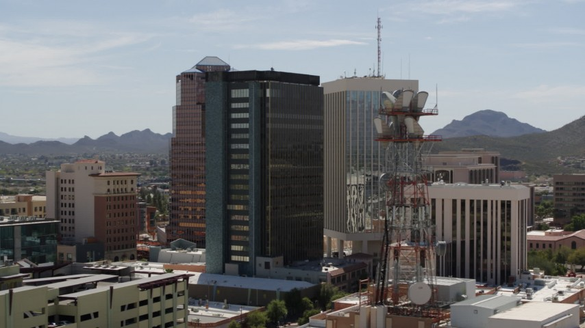 5.7K stock footage aerial video descend to orbit office towers in Downtown Tucson, Arizona Aerial Stock Footage | DX0002_144_017
