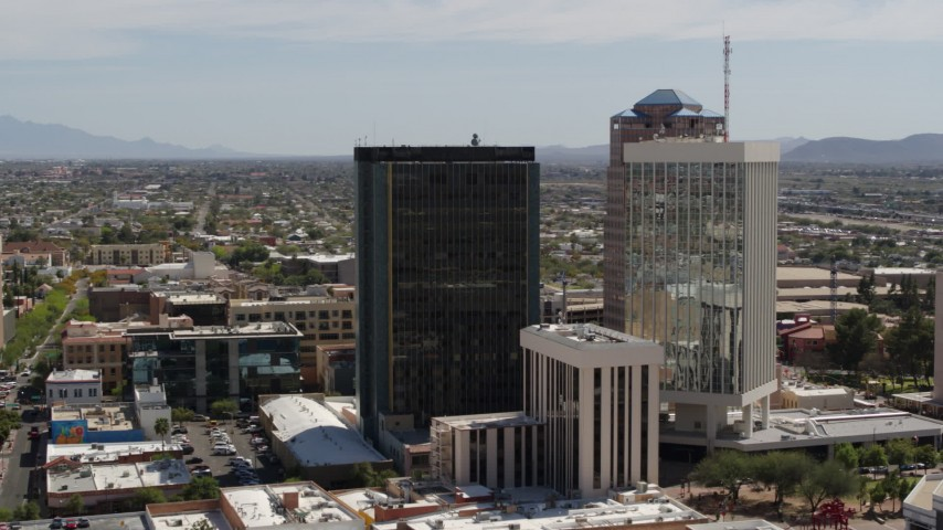 5.7K stock footage aerial video of orbiting and flying away from tall office high-rises in Downtown Tucson, Arizona Aerial Stock Footage | DX0002_144_018