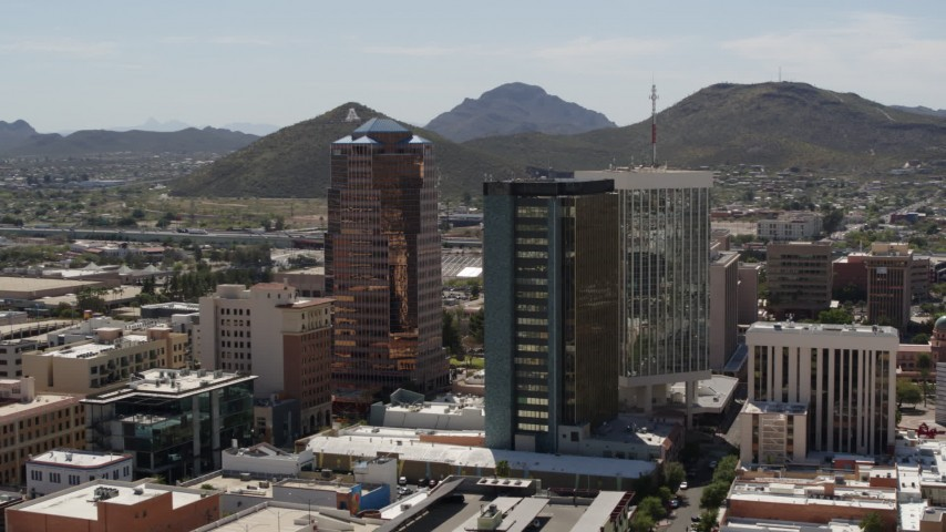 5.7K stock footage aerial video orbiting office towers with Sentinel Peak behind them, Downtown Tucson, Arizona Aerial Stock Footage | DX0002_144_020