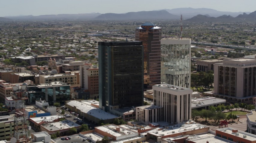 5.7K stock footage aerial video of flying by tall high-rise office towers, Downtown Tucson, Arizona Aerial Stock Footage | DX0002_144_024