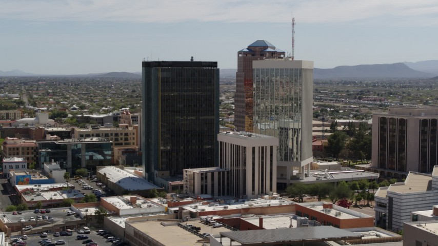 5.7K stock footage aerial video of tall high-rise office towers seen during descent, Downtown Tucson, Arizona Aerial Stock Footage | DX0002_144_025