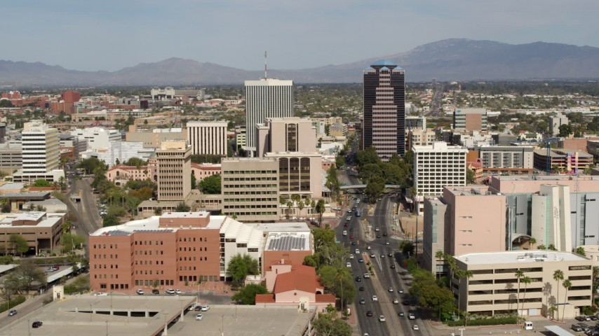 5.7K stock footage aerial video of ascend with view of tall high-rise office towers in Downtown Tucson, Arizona Aerial Stock Footage | DX0002_144_026