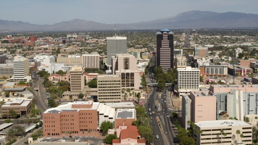 5.7K stock footage aerial video of flying by tall high-rise office towers and city buildings in Downtown Tucson, Arizona Aerial Stock Footage | DX0002_144_027