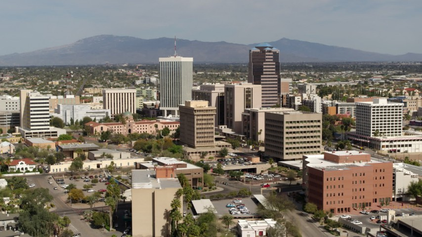 5.7K stock footage aerial video of flying past tall high-rise office towers, city buildings in Downtown Tucson, Arizona Aerial Stock Footage DX0002_144_029 | Axiom Images