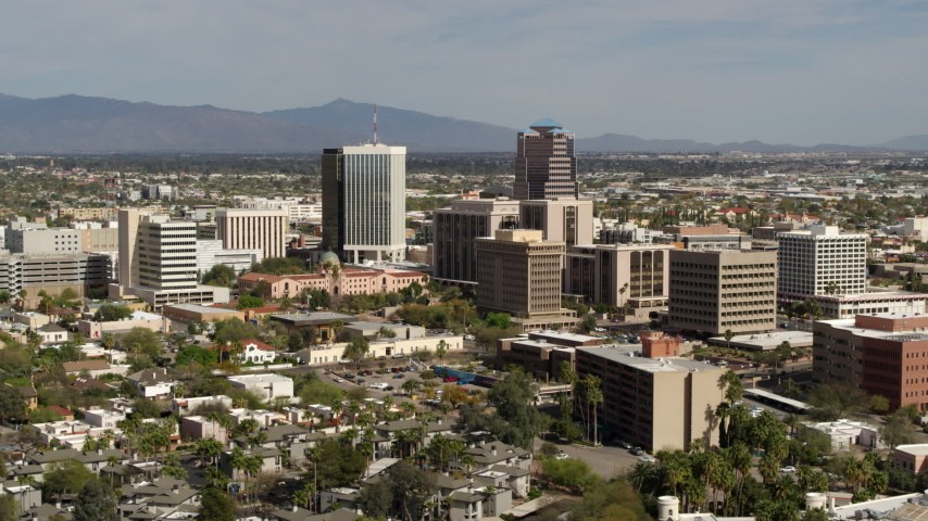 5.7K stock footage aerial video of tall high-rise office towers and city buildings while ascending in Downtown Tucson, Arizona Aerial Stock Footage | DX0002_144_031
