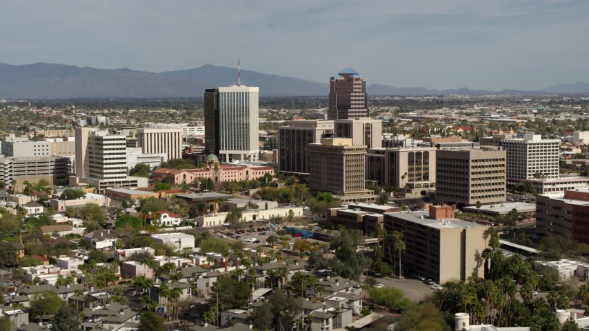 5.7K stock footage aerial video of focusing on tall high-rise office towers and city buildings in Downtown Tucson, Arizona Aerial Stock Footage | DX0002_144_032