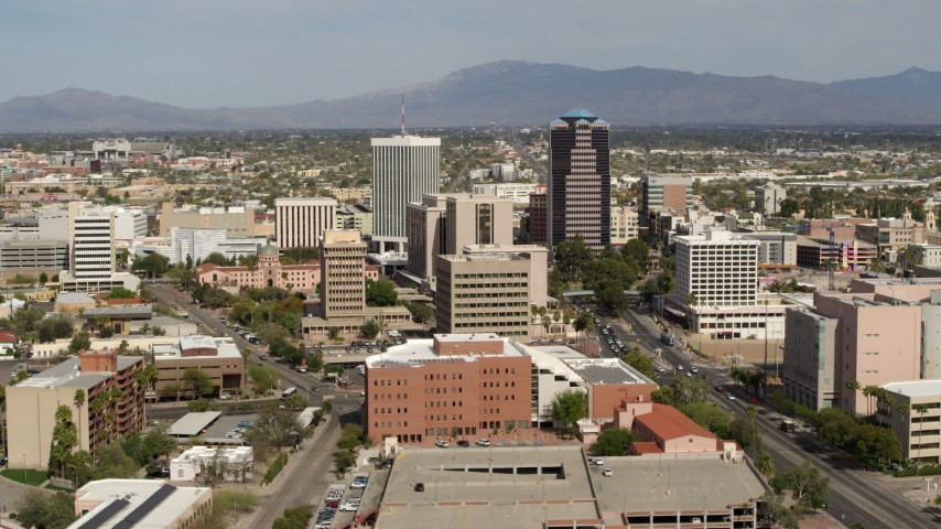 5.7K stock footage aerial video focus on tall office high-rises surrounded by city buildings in Downtown Tucson, Arizona Aerial Stock Footage | DX0002_144_034
