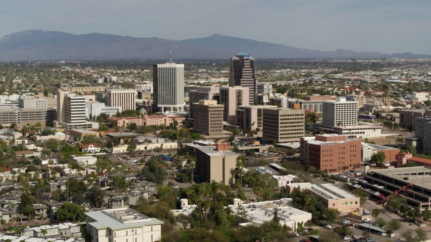 5.7K stock footage aerial video reverse view of tall office high-rises surrounded by city buildings in Downtown Tucson, Arizona Aerial Stock Footage | DX0002_144_035