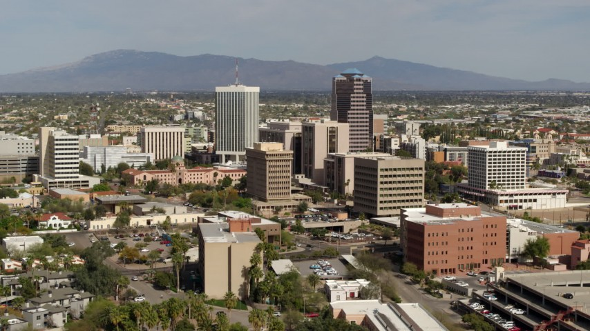 5.7K stock footage aerial video approach tall office high-rises surrounded by city buildings in Downtown Tucson, Arizona Aerial Stock Footage | DX0002_144_036